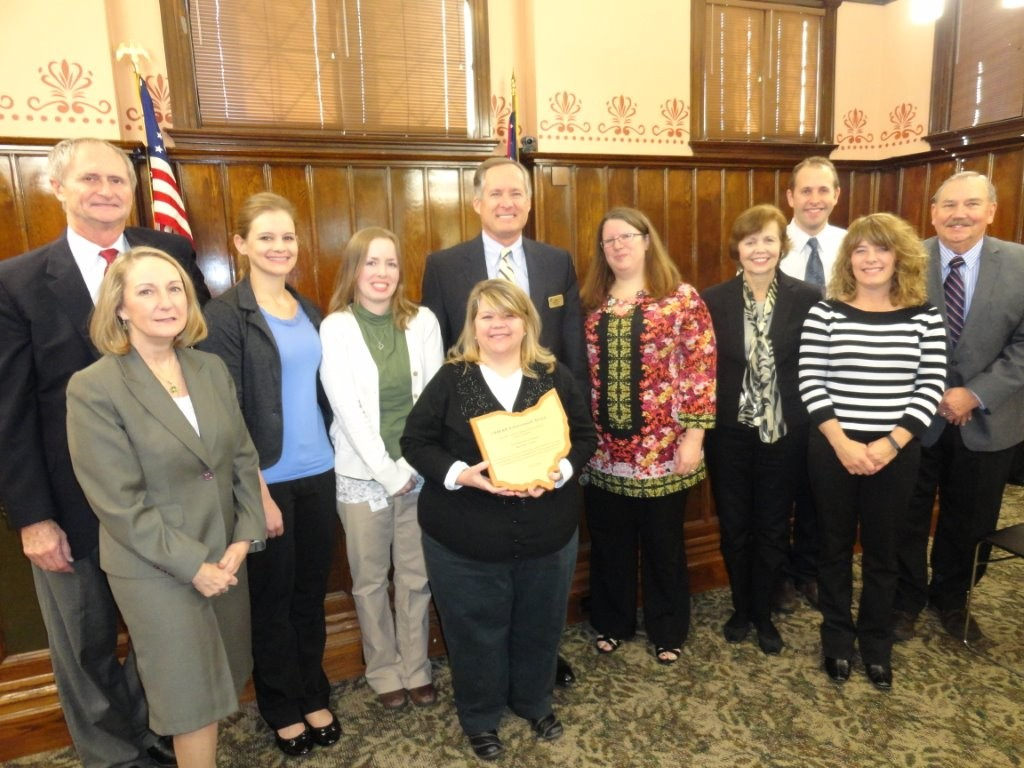 Delaware County Records Center Coordinator Christine Shaw (holding plaque) and her staff received the 2015 Achievement Award from the Ohio Historical Records Advisory Board during the county commission meeting on November 16, 2015. Pictured from left to right, County Prosecutor Carol O'Brien, Commissioner Gary Merrell, Records Technician Alison Miller, Records Technician Megan Henry, Commissioner Jeff Benton, Ohio Historical Records Advisory Board member Pari Swift, Commissioner Barb Lewis, Ohio Historical Records Advisory Board member Stephen Badenhop, Records Technician Sharrie Doubikin and County Auditor George Kaitsa.