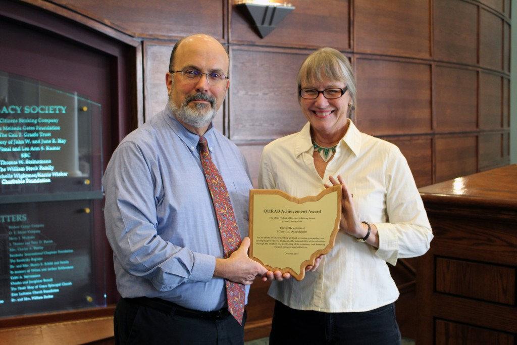 Ohio Historical Records Advisory Board member, Ron Davidson (Sandusky Library) presenting Leslie Korenko, Kelleys Island Historical Association board member, the 2015 OHRAB Achievement Award.
